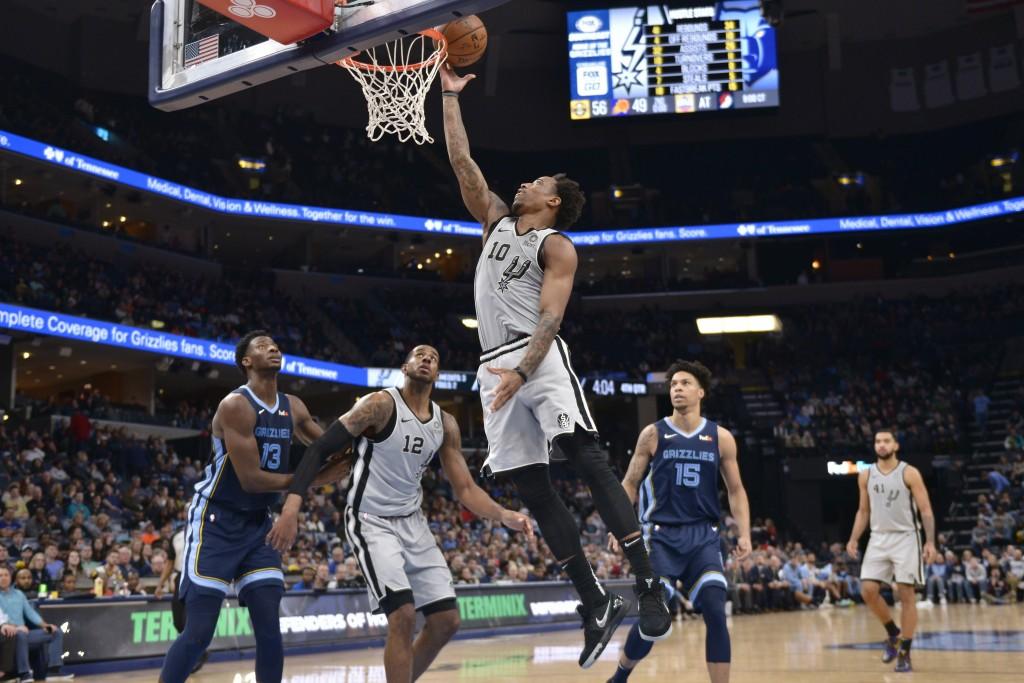 San Antonio Spurs guard DeMar DeRozan (10) shoots ahead of Memphis Grizzlies forward Jaren Jackson Jr. (13), Spurs center LaMarcus Aldridge (12), and ...