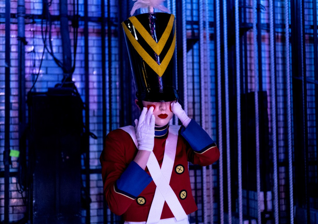 In this Monday, Nov. 25, 2019 photo, Rockette Sydney Mesher adjusts part of her Wooden Solider costume backstage during a performance of the Christmas...