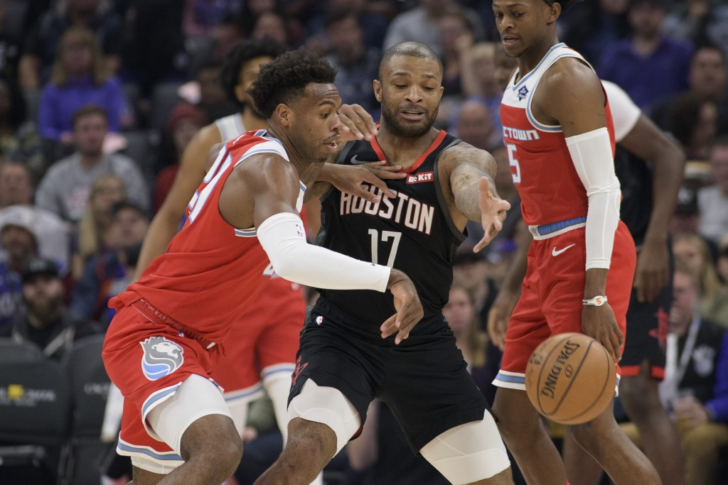 Sacramento Kings guard Buddy Hield (24) defends against Houston Rockets forward PJ Tucker (17) during the first quarter of an NBA basketball game in S...
