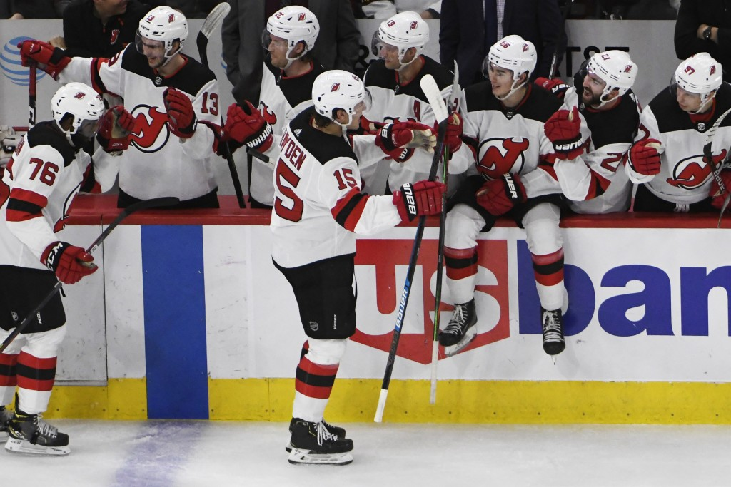 New Jersey Devils center John Hayden (15) celebrates his goal against the Chicago Blackhawks with his teammates during the second period of an NHL hoc...