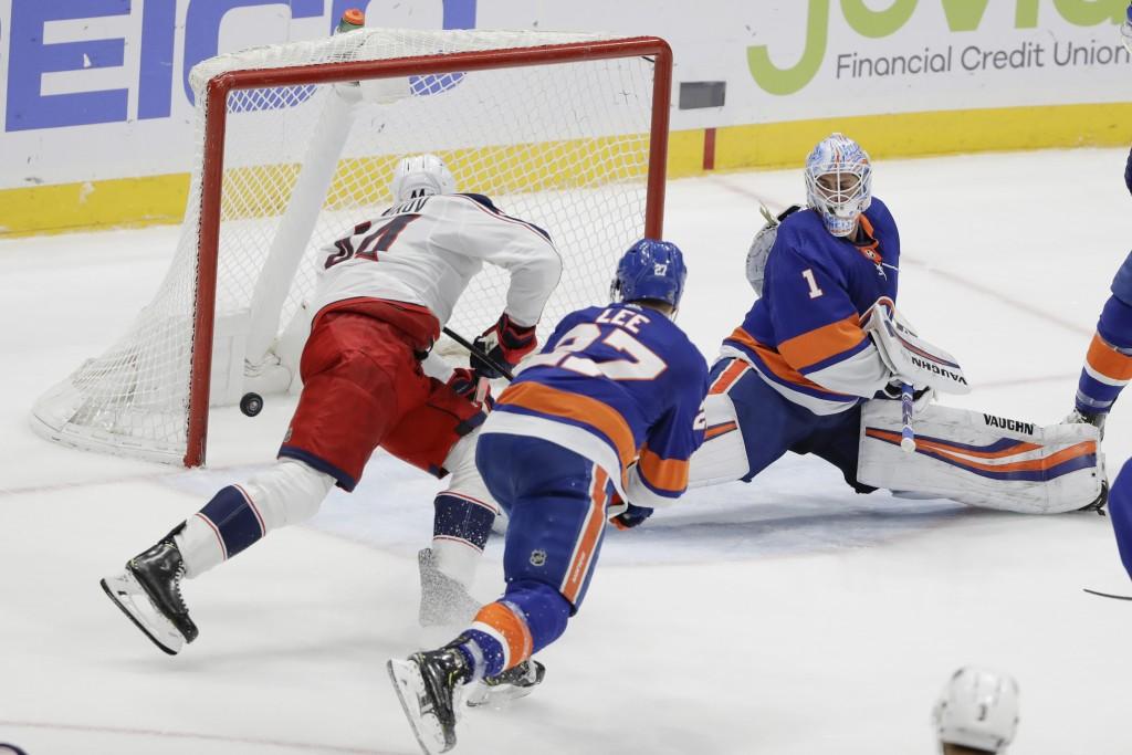 New York Islanders goaltender Thomas Greiss (1) reacts as Columbus Blue Jackets' Vladislav Gavrikov, left, shoots the puck past him for the game winni...