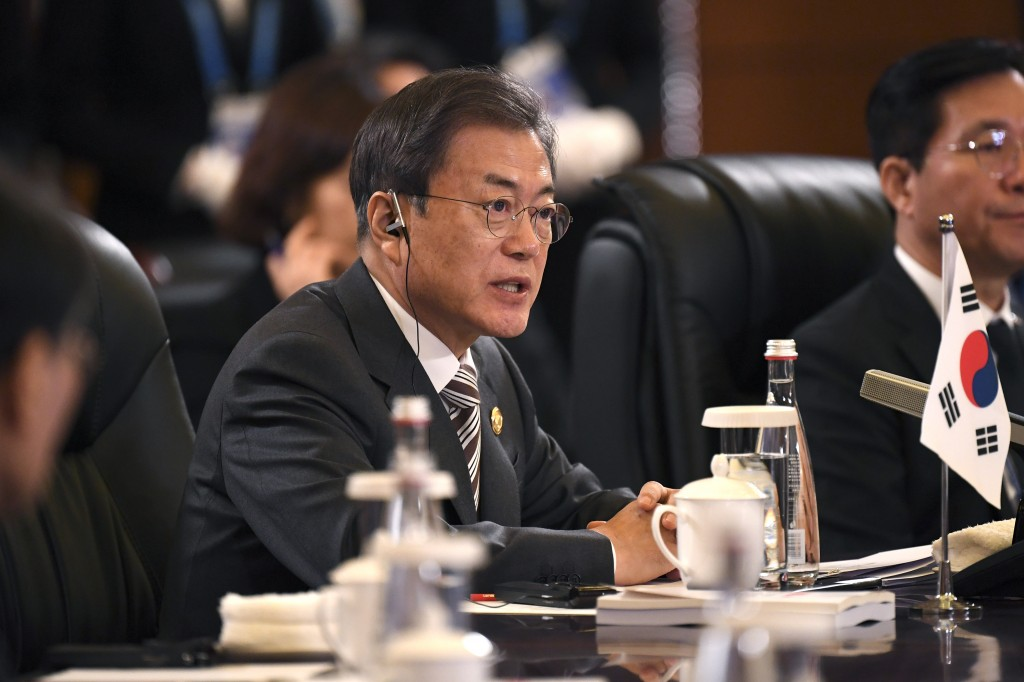 South Korea's President Moon Jae-in speaks at the trilateral leaders' meeting between China, South Korea and Japan in Chengdu, China's Sichuan provinc...