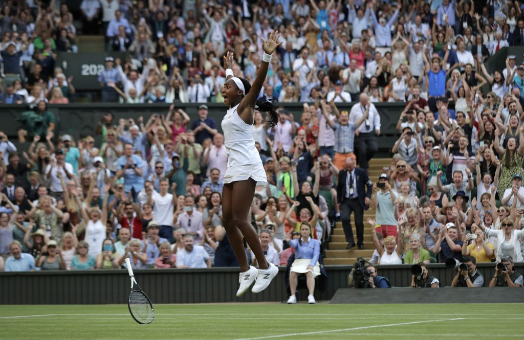 """File-This July 5, 2019 file photo shows United States' Cori """"Coco"""" Gauff celebrating after beating Slovenia's Polona Hercog in a Women's singles match..."""