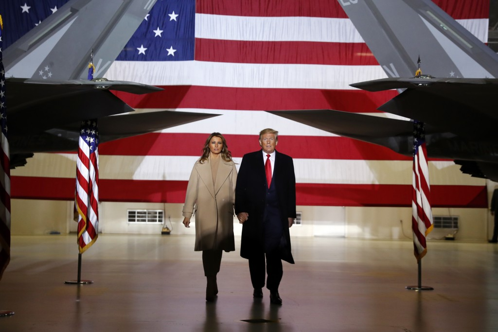 FILE - In this Dec. 20, 2019, file photo, President Donald Trump arrives with first lady Melania Trump to sign the National Defense Authorization Act ...