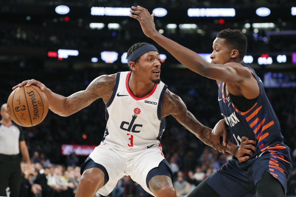 New York Knicks guard Frank Ntilikina (11) defends against Washington Wizards guard Bradley Beal (3) during the first half of an NBA basketball game i...