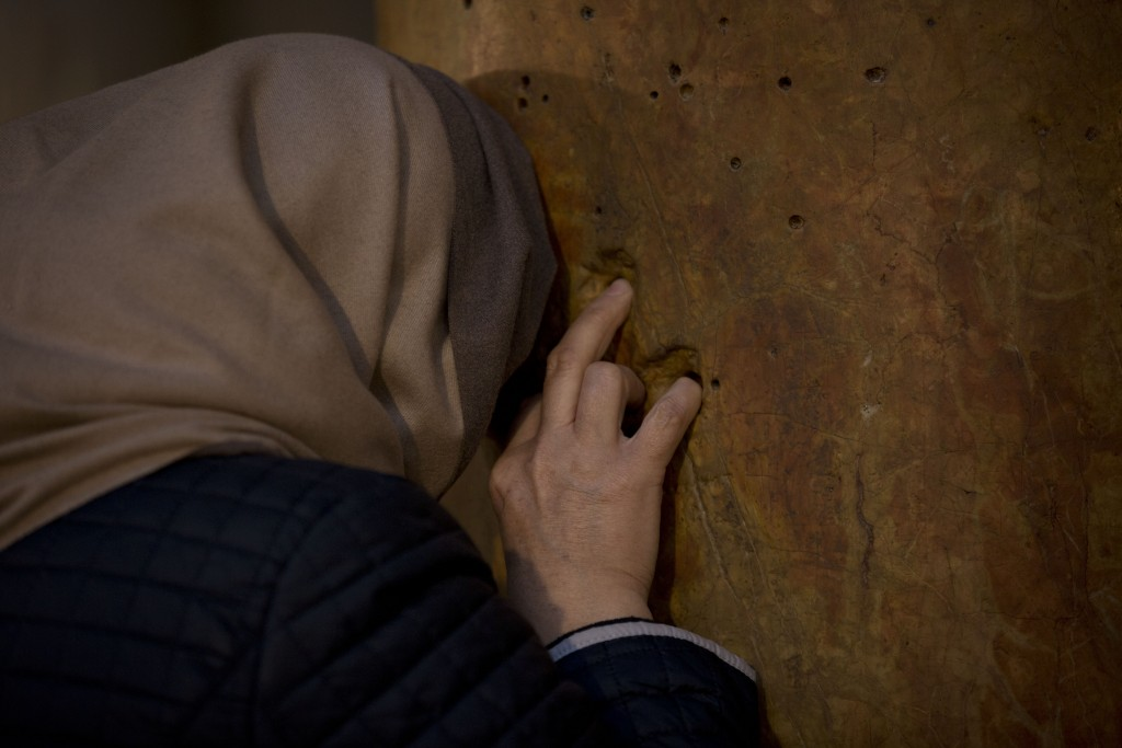 A worshipper prays inside the Church of the Nativity, built on top of the site where Christians believe Jesus Christ was born, on Christmas Eve, in th...
