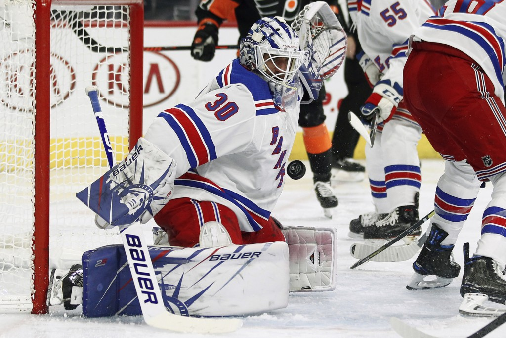 New York Rangers' Henrik Lundqvist turns away a shot on goal during the second period of an NHL hockey game against the Philadelphia Flyers, Monday, D...
