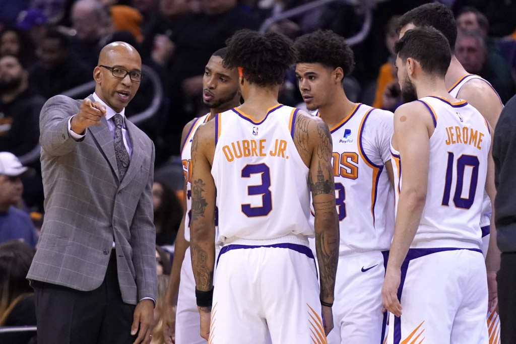 Phoenix Suns head coach Monty Williams talks to his team during a timeout in the first half during an NBA basketball game against the Denver Nuggets, ...