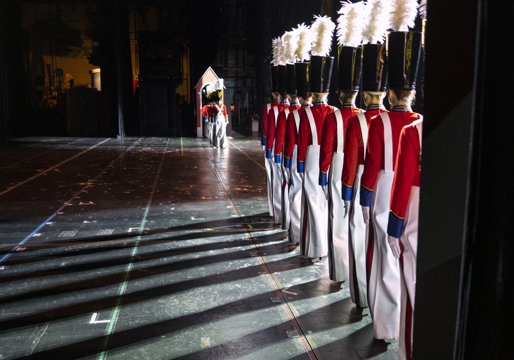 In this Monday, Nov. 25, 2019 photo Rockette Sydney Mesher, first in line at right, takes the stage as a Wooden Solider during a performance of the Ch...