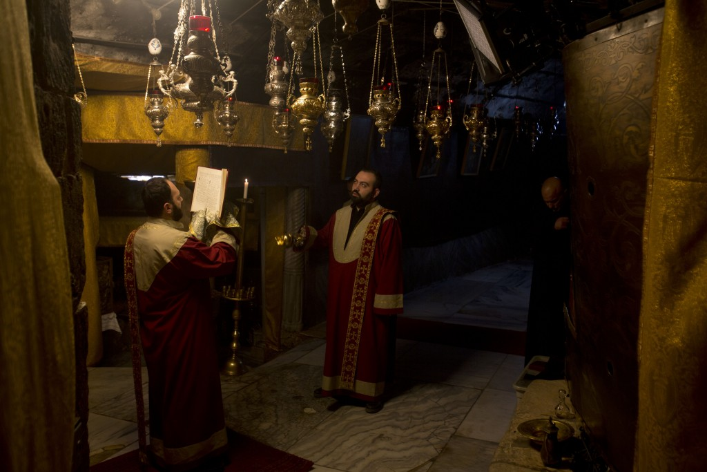 Christian Armenian pray inside the Grotto of the Church of the Nativity, traditionally believed by Christians to be the birthplace of Jesus Christ, in...