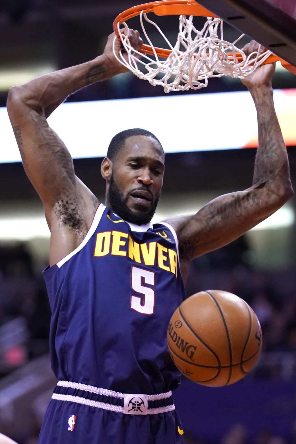 Denver Nuggets guard Will Barton (5) dunks in the first half of an NBA basketball game against the Phoenix Suns, Monday, Dec. 23, 2019, in Phoenix. (A...