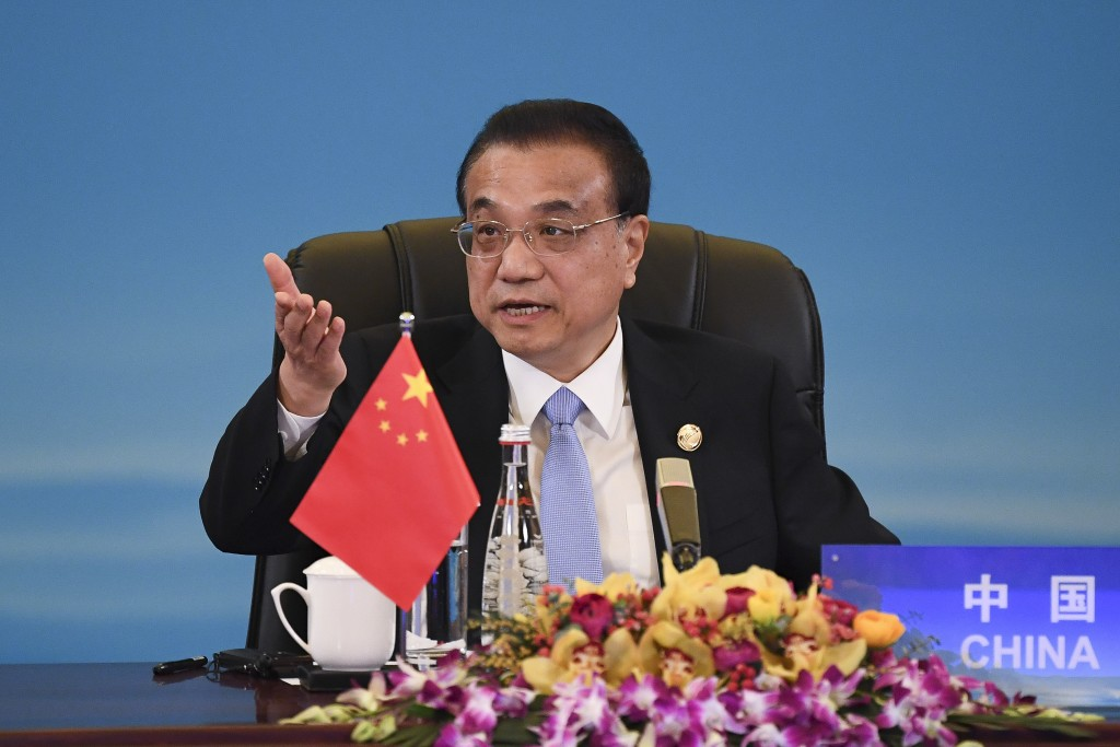 China's Premier Li Keqiang speaks at the trilateral leaders' meeting between China, South Korea and Japan in Chengdu, China's Sichuan province Tuesday...