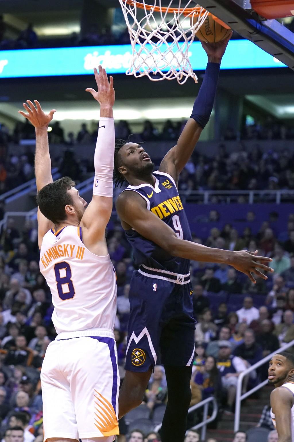 Denver Nuggets forward Jerami Grant shoots over Phoenix Suns forward Frank Kaminsky (8) in the first half during an NBA basketball game, Monday, Dec. ...