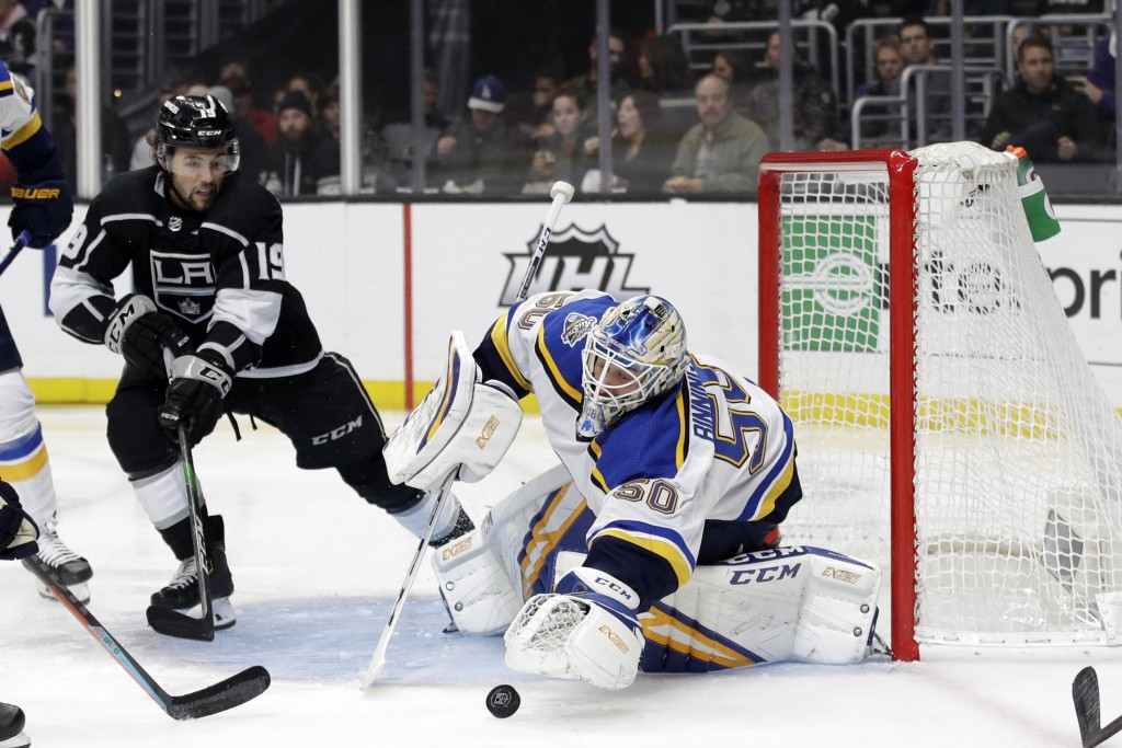 St. Louis Blues goaltender Jordan Binnington, right, stops a shot in front of Los Angeles Kings' Alex Iafallo during the second period of an NHL hocke...