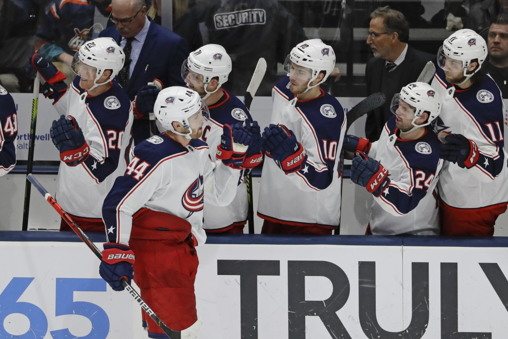 Columbus Blue Jackets' Vladislav Gavrikov (44) celebrates with teammates after scoring a goal during the third period of an NHL hockey game against th...