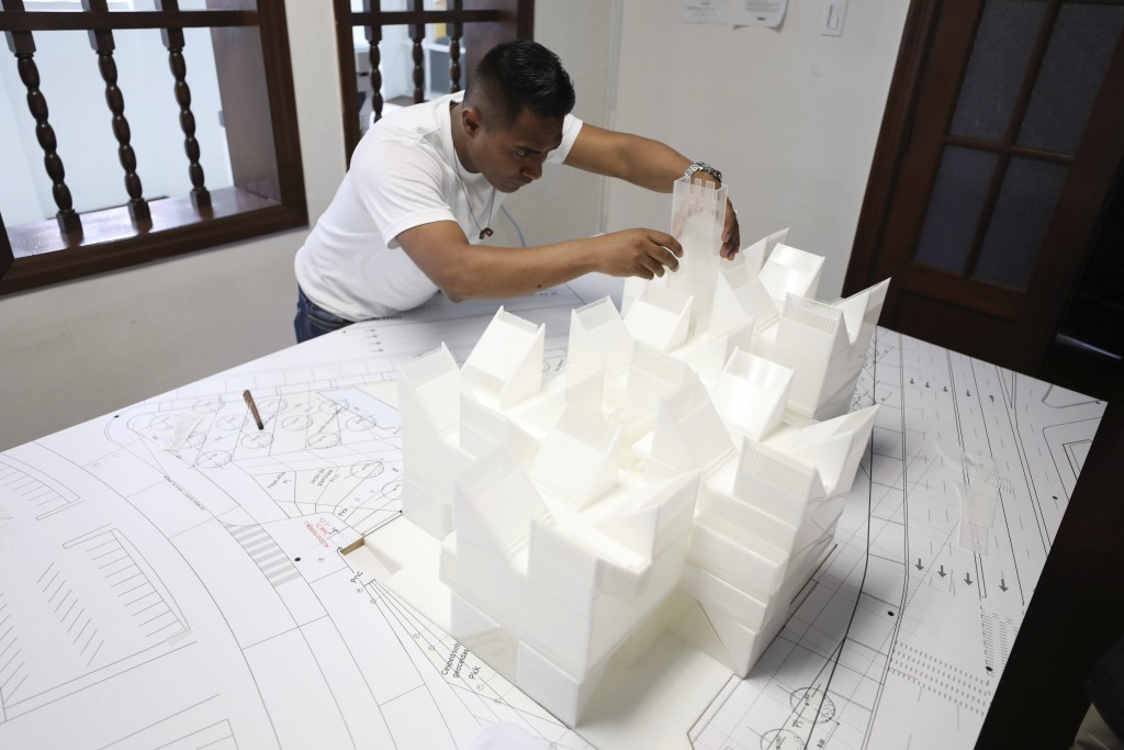 An architect works on the model of the planned Museum of Memory in Bogota, Colombia, Thursday, Dec. 12, 2019. Colombia's government hopes to build a l...