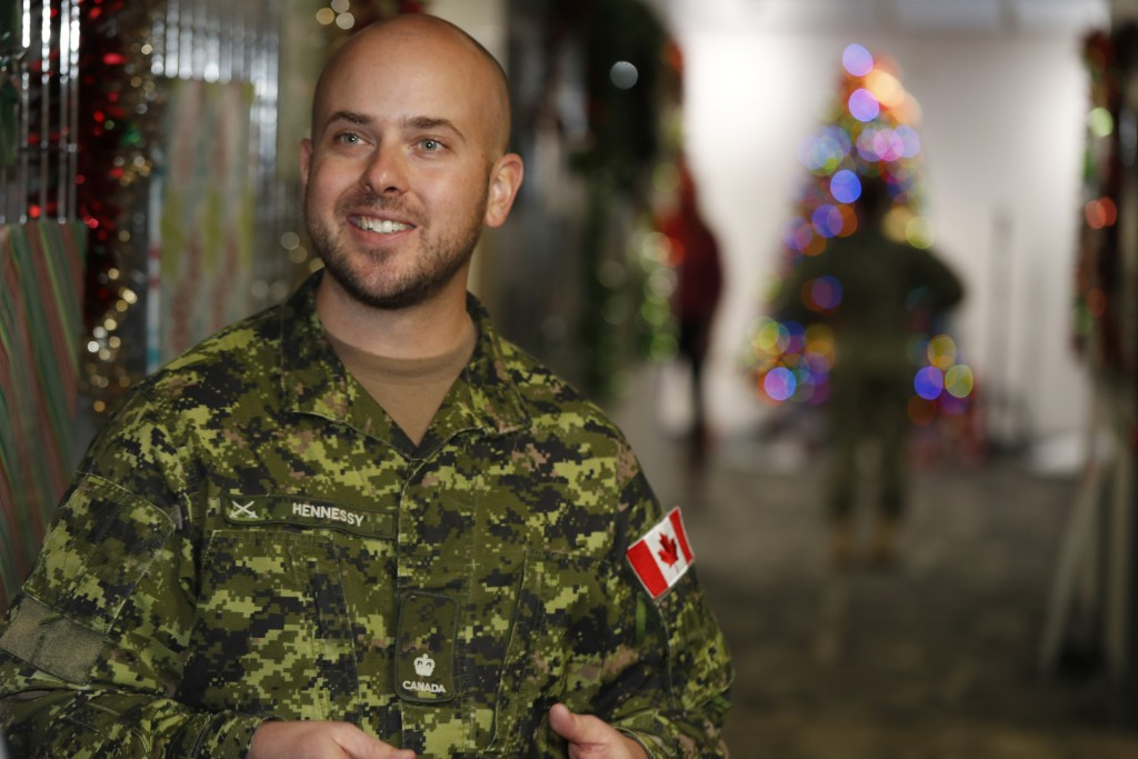 Canadian Armed Forces Major Andrew Hennessy, of Armstrong, B.C., talks about the volunteer effort in the NORAD Tracks Santa center at Peterson Air For...