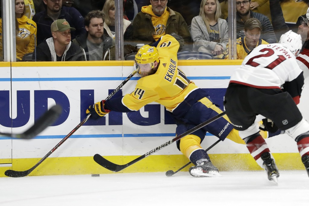 Nashville Predators defenseman Mattias Ekholm (14), of Sweden, and Arizona Coyotes center Derek Stepan (21) vie for the puck in the second period of a...