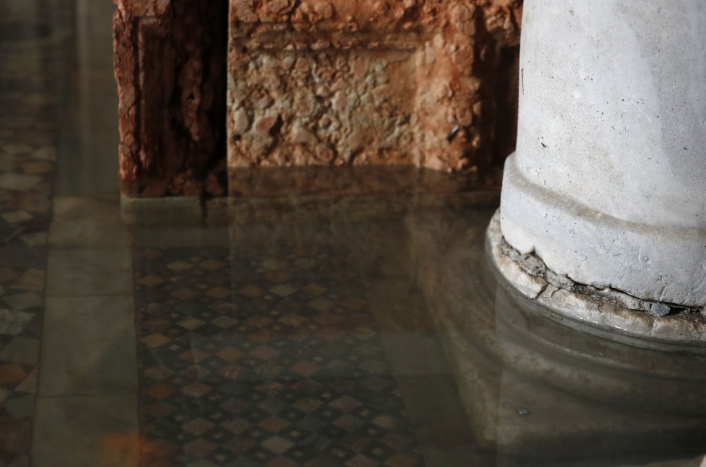 A view of a floor during a high waters flooded inside the St. Mark's Basilica in Venice, Italy, Tuesday, Dec. 17, 2019.  Still invisible to the naked ...
