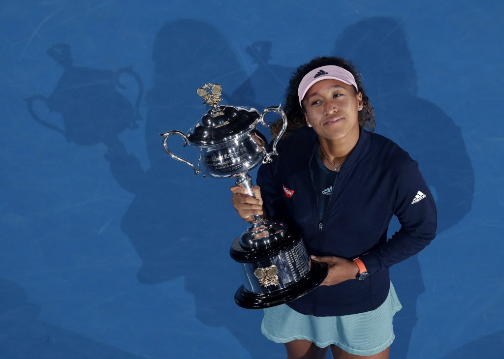 File-This Jan. 26, 2019, file photo shows Japan's Naomi Osaka holding her trophy after defeating Petra Kvitova of the Czech Republic during the women'...
