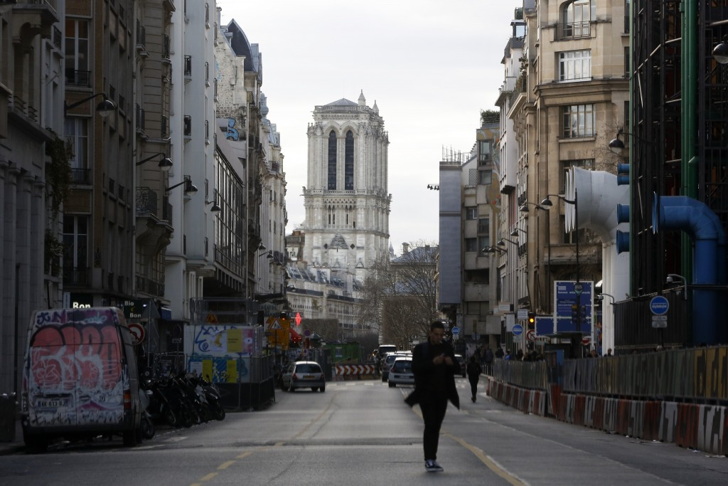 Notre Dame cathedral, background, is pictured in Paris, Wednesday, Dec. 25, 2019. The rector of Notre Dame Cathedral says the Paris landmark is still ...
