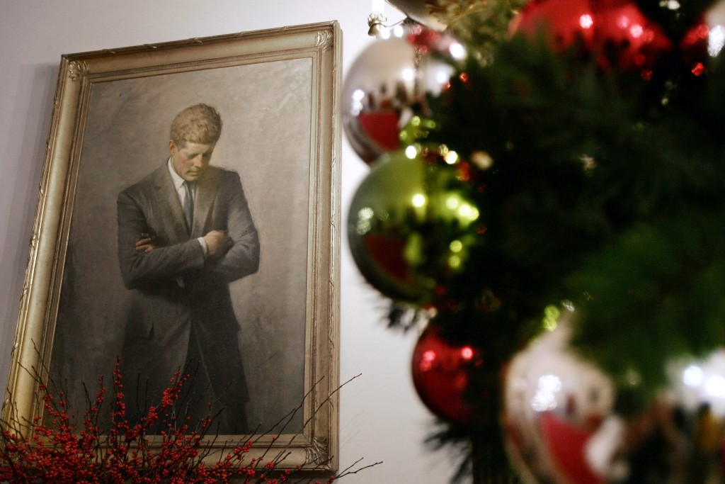FILE - In this Nov. 30, 2006, file photo, a portrait of former President John F. Kennedy, framed by Christmas decorations, hangs in the White House in...