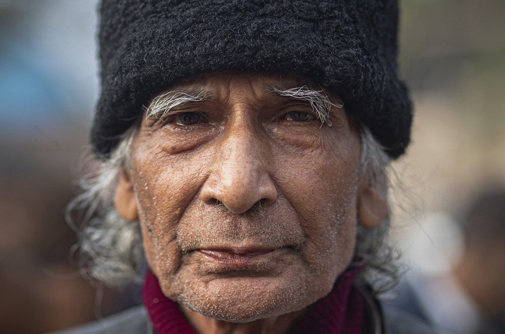 In this Monday, Dec. 23, 2019, photo, Gajendra Nath Pathak, 81, participates in a protest against Citizenship Amendment Act in Gauhati, India. Tens of...
