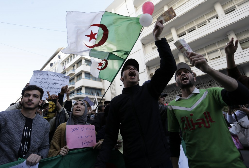 In this photo taken on Tuesday, Dec. 24, 2019, students take to the streets in the capital Algiers to protest against the government, in Algeria. (AP ...