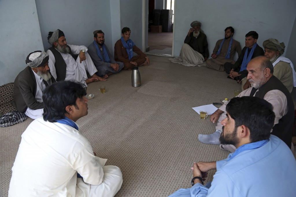FILE - In this Aug. 29, 2019 filephoto, members of the peace movement chat after an interview in Kabul, Afghanistan. On Tuesday, Dec. 24, 2019, the Ta...