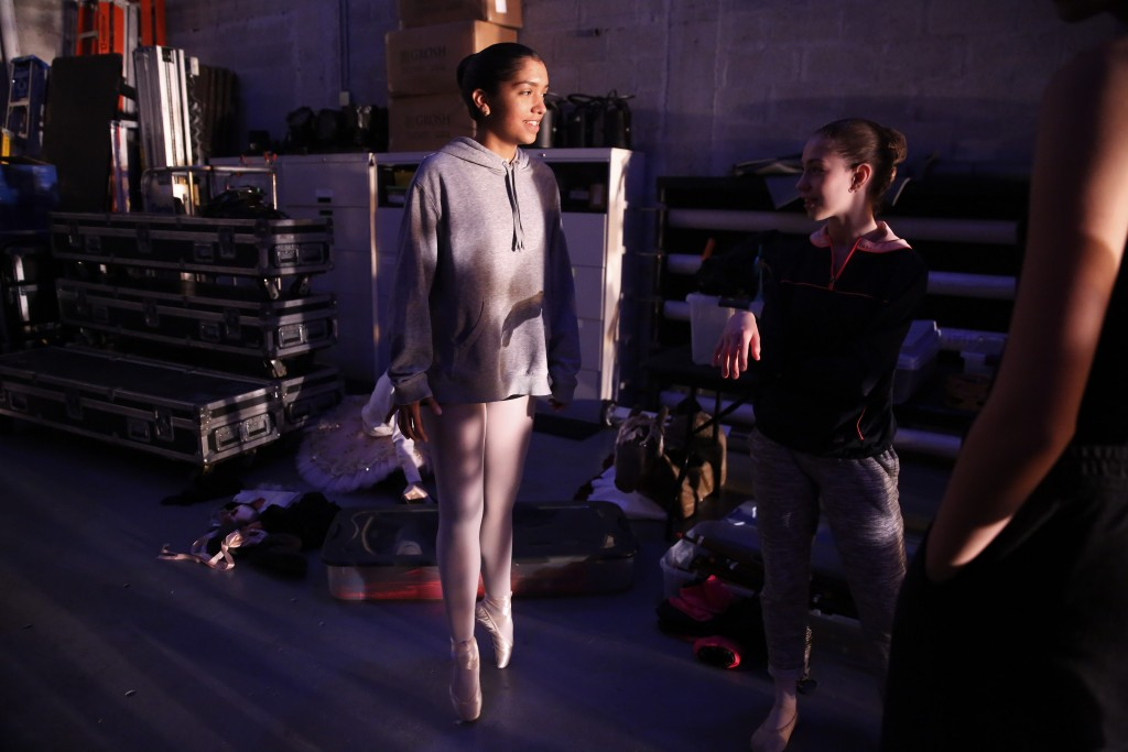 Paola Nava, right, 17, stretches her feet backstage during a rehearsal of Vladimir Issaev's rendition of The Nutcracker ballet on Friday, Dec. 13, 201...