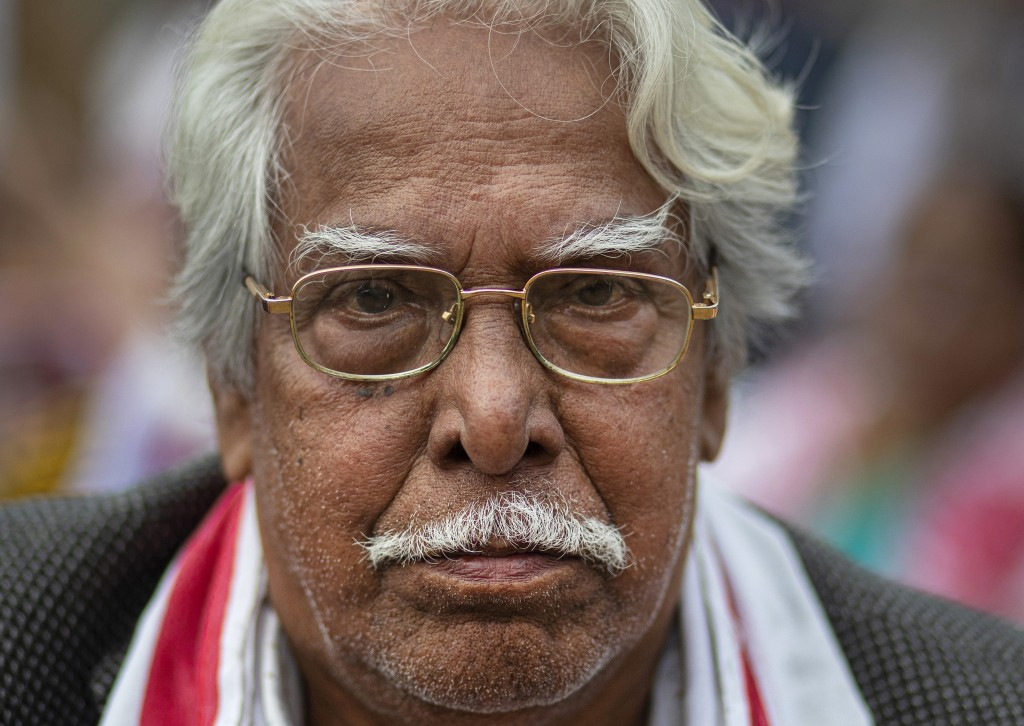 In this Monday, Dec. 23, 2019, photo, Nityananda Phukan, 77, participates in a protest against the Citizenship Amendment Act (CAA) in Gauhati, India. ...