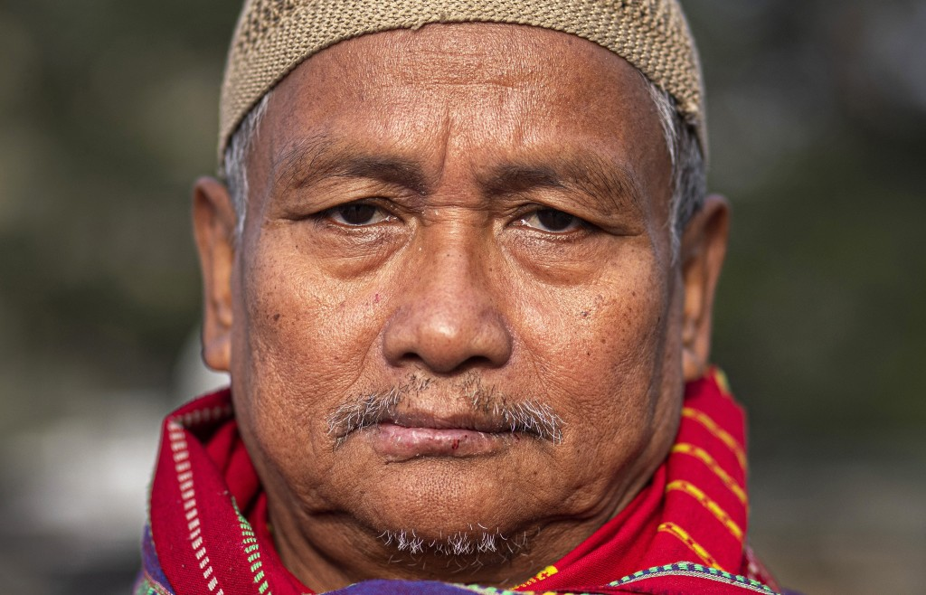 In this Monday, Dec. 23, 2019, photo, Kalparanjan Gogoi, 64, participates in a protest against the Citizenship Amendment Act (CAA) in Gauhati, India. ...