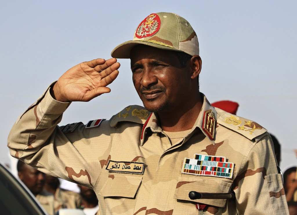 FILE - In this June 15, 2019 file photo, Gen. Mohammed Hamdan Dagalo, the deputy head of the military council, salutes during a rally, in Galawee, nor...