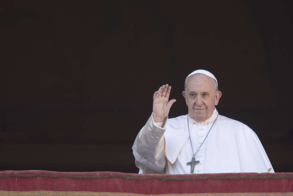 Pope Francis waves to faithful as he arrives to deliver the Urbi et Orbi (Latin for 'to the city and to the world' ) Christmas' day blessing from the ...
