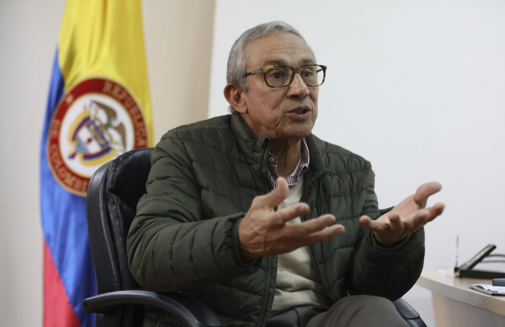 Dario Acevedo, director of the National Center for Historical Memory, speaks during an interview at his office in Bogota, Colombia, Thursday, Dec. 12,...
