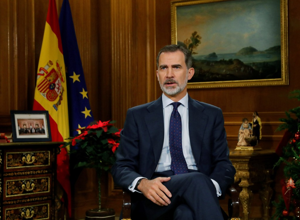 In this photo released on Tuesday Dec. 24, 2019, Spain's King Felipe VI delivers his traditional annual Christmas speech from the Zarzuela Palace in M...