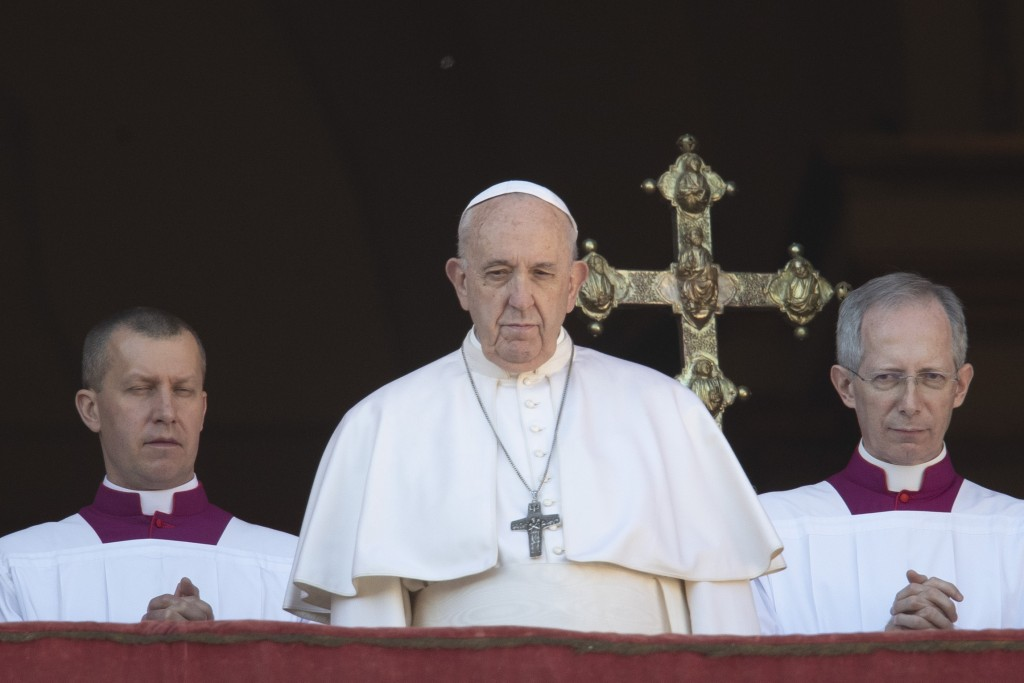 Pope Francis looks at the crowd after he delivered the Urbi et Orbi (Latin for 'to the city and to the world' ) Christmas' day blessing from the main ...