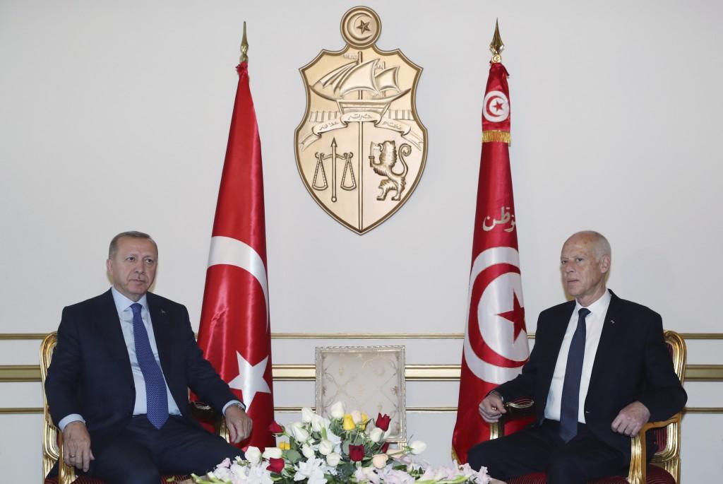 Turkey's President Recep Tayyip Erdogan, left, and Tunisian President Kais Saied pose during a meeting, in Tunis, Tunisia, Wednesday, Dec. 25, 2019. E...