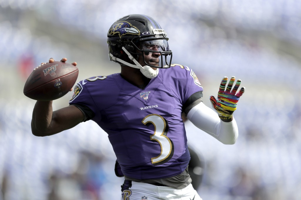 FILE - In this Oct. 13, 2019, file photo Baltimore Ravens quarterback Robert Griffin III works out prior to an NFL football game against the Cincinnat...