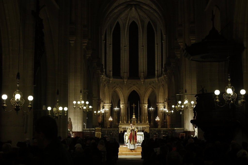 Priest Jean-Philippe Fabre celebrates the christmas mass, in Saint-Germain l'Auxerrois church, in Paris, Tuesday, Dec. 24, 2019. Notre Dame Cathedral ...