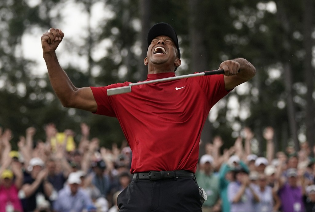 FILE - In this April 14, 2019 file photo, Tiger Woods reacts as he wins the Masters golf tournament in Augusta, Ga. Woods' victory at the Masters migh...