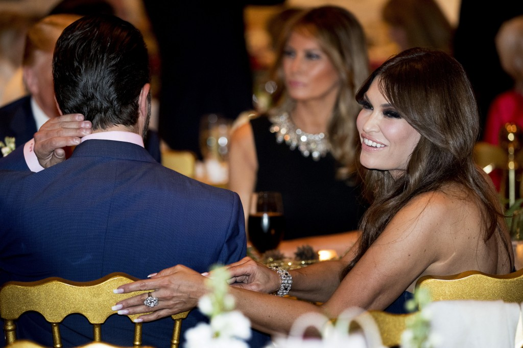 Kimberly Guilfoyle, right, and Donald Trump Jr., the son of President Donald Trump, left, sit with President Donald Trump, background left, and first ...