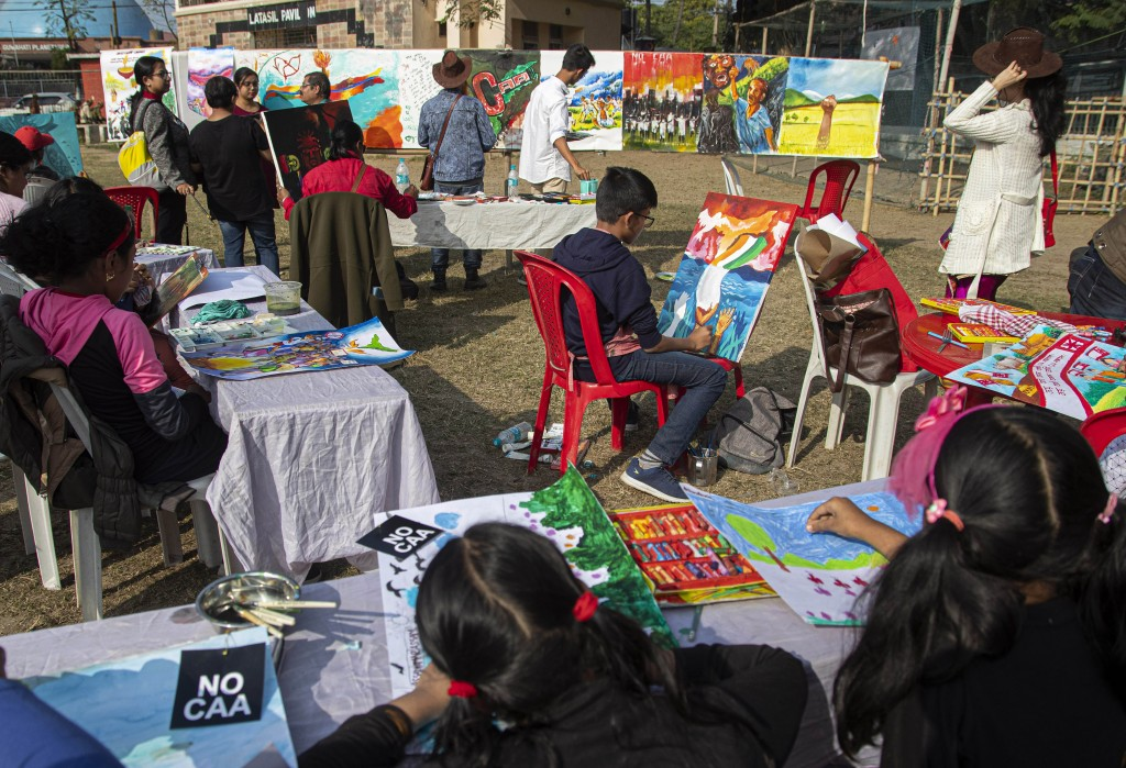 Indian artists, mostly students, paint on canvases at an event organized by a students organization to protest against a new citizenship law that oppo...