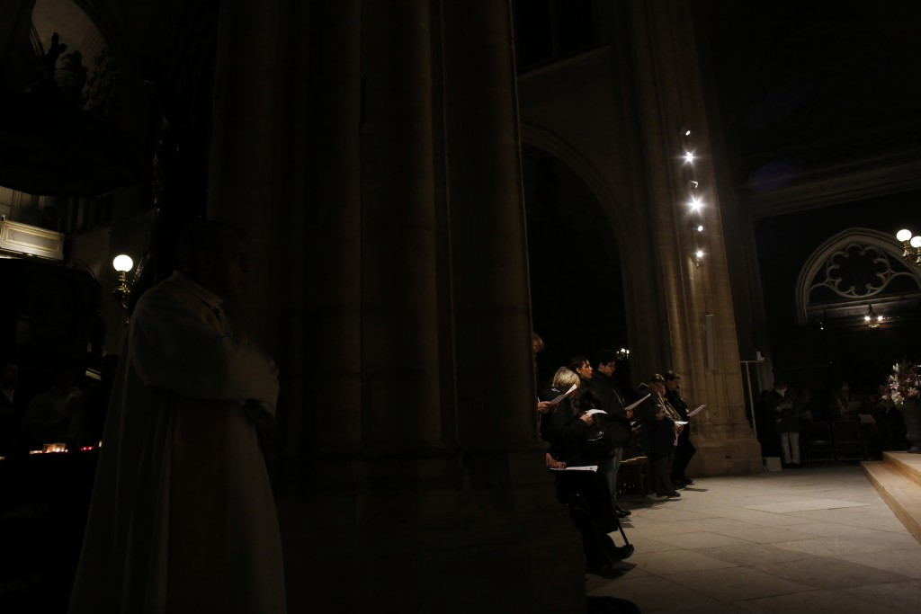 Believers the christmas mass, in Saint-Germain l'Auxerrois church, in Paris, Tuesday, Dec. 24, 2019. Notre Dame Cathedral is unable to host Christmas ...