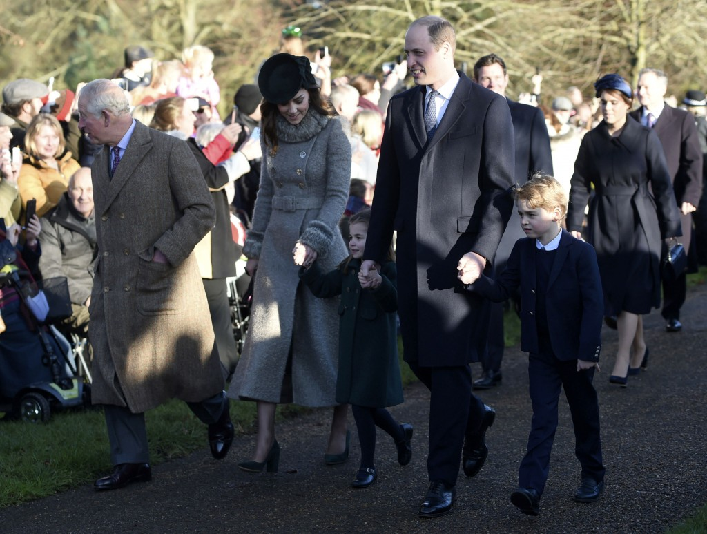 Britain's Prince Charles, Kate, Duchess of Cambridge, Prince William and their children Prince George, right, and Princess Charlotte arrive to attend ...