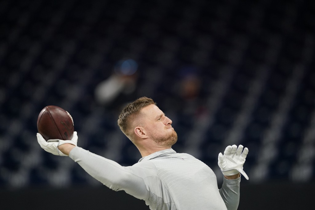FILE - In this Dec. 1, 2019, file photo Houston Texans defensive end J.J. Watt before an NFL football game against the New England Patriots in Houston...