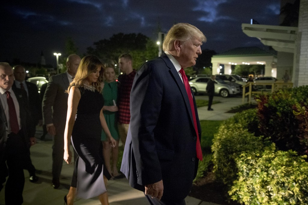 President Donald Trump and first lady Melania Trump arrive for Christmas Eve service at Family Church Downtown in West Palm Beach, Fla., Tuesday, Dec....