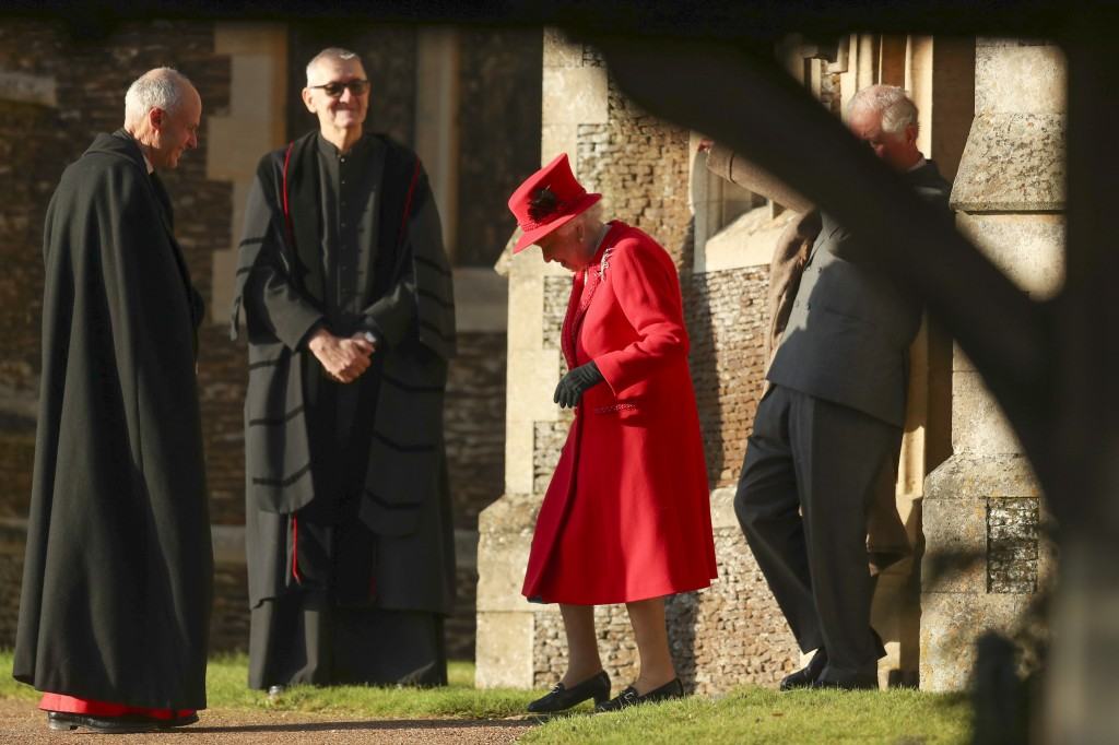 Britain's Queen Elizabeth II arrives to attend the Christmas day service at St Mary Magdalene Church in Sandringham in Norfolk, England, Wednesday, De...