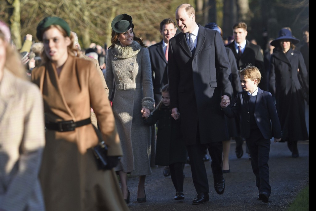 Kate, Duchess of Cambridge, Prince William and their children Prince George, right, and Princess Charlotte arrive to attend the Christmas Day morning ...
