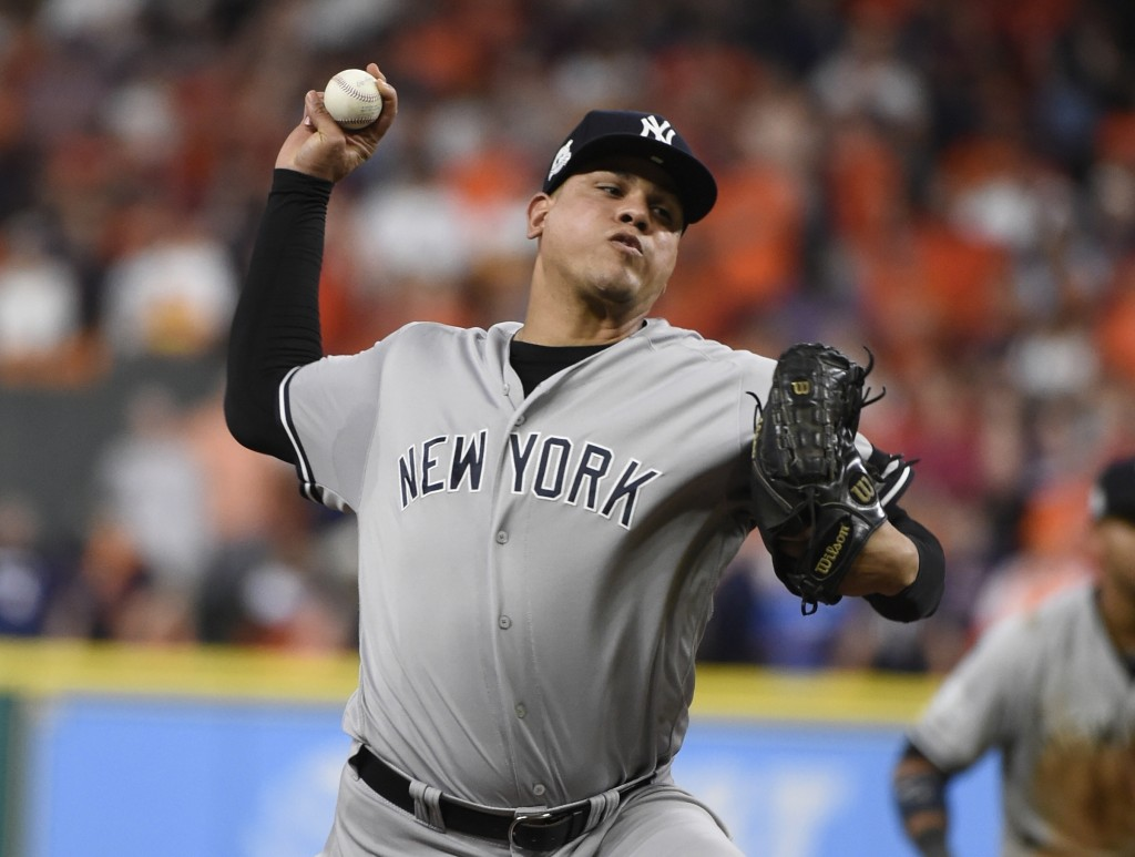FILE - In this Oct. 20, 2017, file photo, New York Yankees relief pitcher Dellin Betances throws during the eighth inning of Game 6 of baseball's Amer...